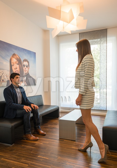Office interior - receptionist and visitor Stock Photo
