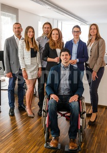 Portrait Of Business Team With Wheelchair Stock Photo