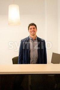 Young receptionist smiling Stock Photo