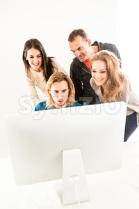 Abstract: Business team in office looking at computer monitor Stock Photo