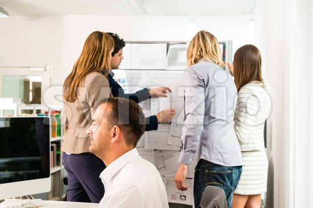 Businesspeople working in office Stock Photo