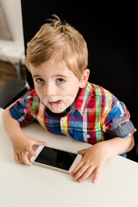 Little boy plays with smartphone Stock Photo