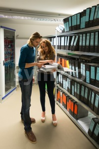 young man and woman in the company archives with servers Stock Photo