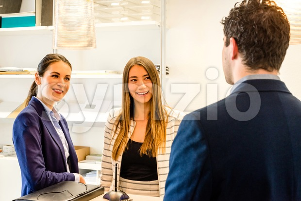 Conversation at the office reception Stock Photo