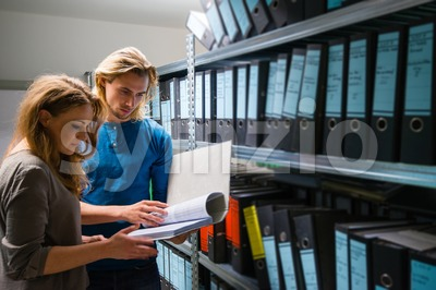 young man and woman in the company archives Stock Photo