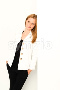 young woman leaning against the wall Stock Photo