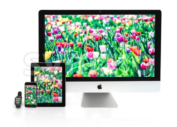 Multiscreen - Apple Watch, iPhone, iPad and iMac screens Stock Photo