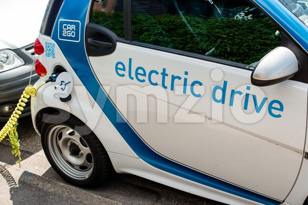 A car-sharing electric Smart is being recharged Stock Photo