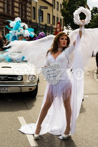 Participant of Christopher Street Day 2015 in Stuttgart, Germany is presenting the motto Stock Photo
