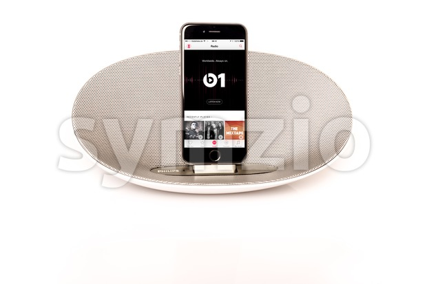 Scharnhausen, Germany - August 06, 2015: Front view of an Apple iPhone 6 in a Philips docking station and speaker ...
