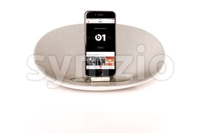 iPhone 6 with loudspeaker playing Apple Music radio Stock Photo