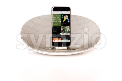iPhone 6 with loudspeaker displaying Apple Music personal recommendations Stock Photo