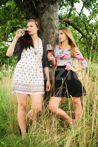Two pretty girls in the garden under a tree Stock Photo