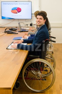 man in wheelchair during business meeting Stock Photo