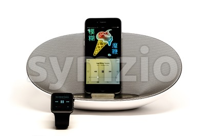 Apple Music - iPhone in Loudspeaker being controlled by the Apple Watch Stock Photo