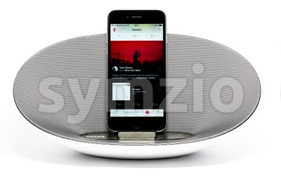 iPhone 6 with loudspeaker playing Apple Music Stock Photo