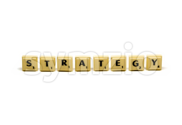 Strategy - conceptual approach using plastic letter tiles forming the two words home and office with shadows on white background