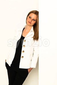 young woman leaning against awall Stock Photo