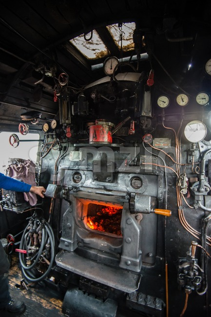 inside the cab of a classic steam locomotive with open fire Stock Photo