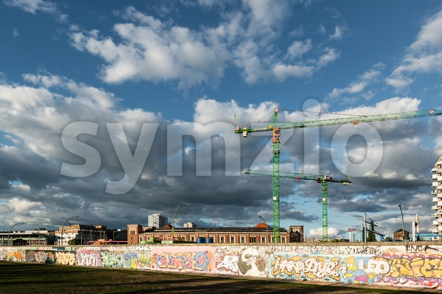Berlin, Germany - September 28, 2015:  Building activity along the East Side Gallery in Berlin, Germany. The East Side ...