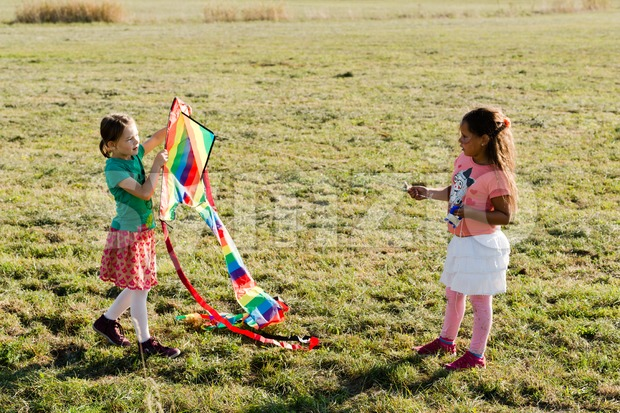 Cute little girls flying a kite Stock Photo