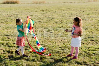Cute little girls flying a kite Stock Photo