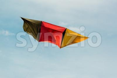 German kite flying in blue sky Stock Photo