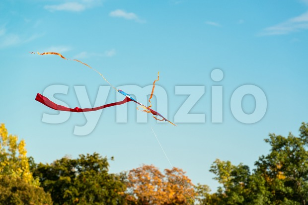 abstract colorful kite flying in blue sky Stock Photo