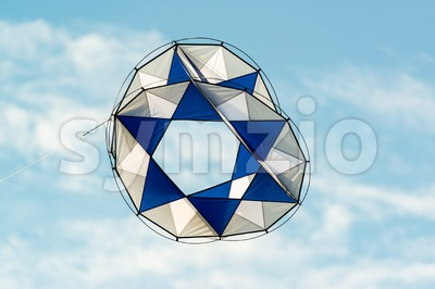 modern kite flying in blue sky Stock Photo