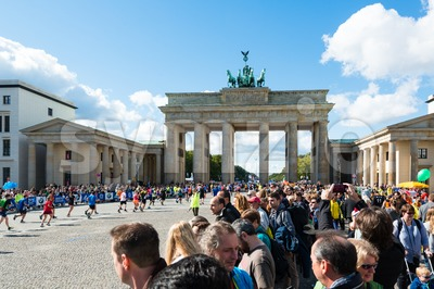 Participants of Berlin Marathon finishing at the Brandenburg Gate Stock Photo