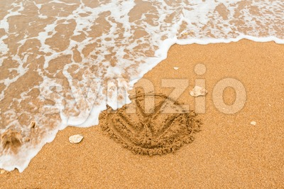 Nature strikes back - Volkswagen logo being washed away Stock Photo