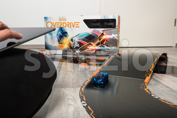 Ostfildern, Germany - November 1, 2015: Test drive of the new Anki Overdrive smart toy car racing using an app ...