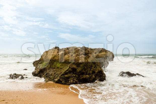 Ocean crashing over rock Stock Photo
