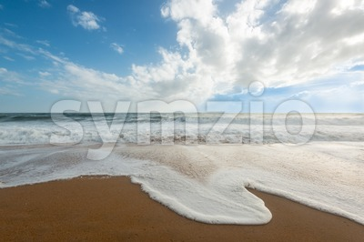 Waves on the beach Stock Photo