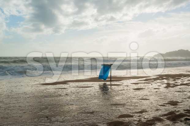 Trash can on the beach Stock Photo