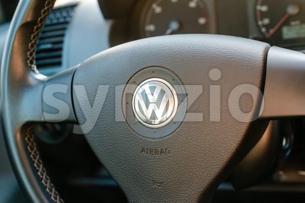 Logo of German car manufacturer Volkswagen on steering wheel Stock Photo