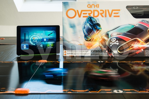 Ostfildern, Germany - November 8, 2015: The new Anki Overdrive smart toy car racing is set up on a living ...
