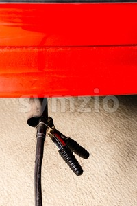 Measuring exhausts of a car in garage Stock Photo