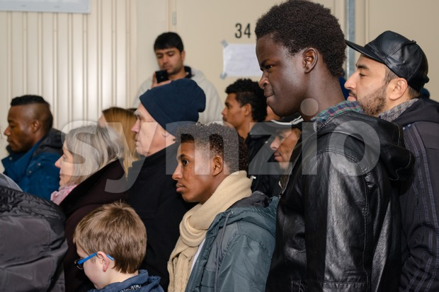Scharnhausen, Germany - December 20, 2015: Refugees from Libya, Nigeria, Afghanistan, Pakistan, Eritrea, Gambia, Togo, Algeria, Tunisia and other countries ...