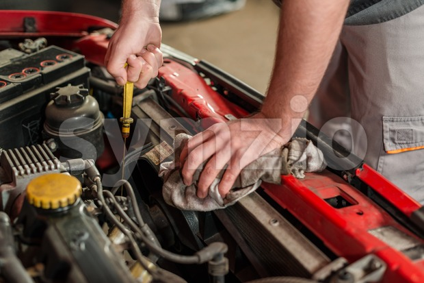 Checking for engine oil on a car Stock Photo