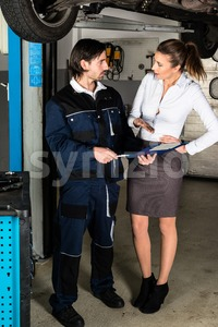 Car mechanic with angry female customer Stock Photo