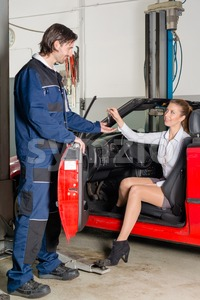 Car mechanic with female customer Stock Photo