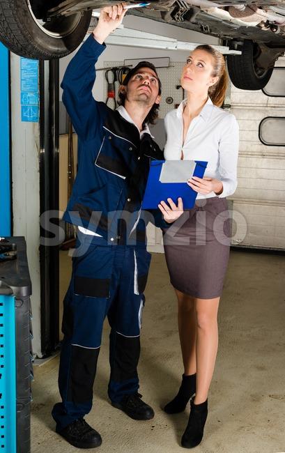 Car mechanic with female customer Stock Photo