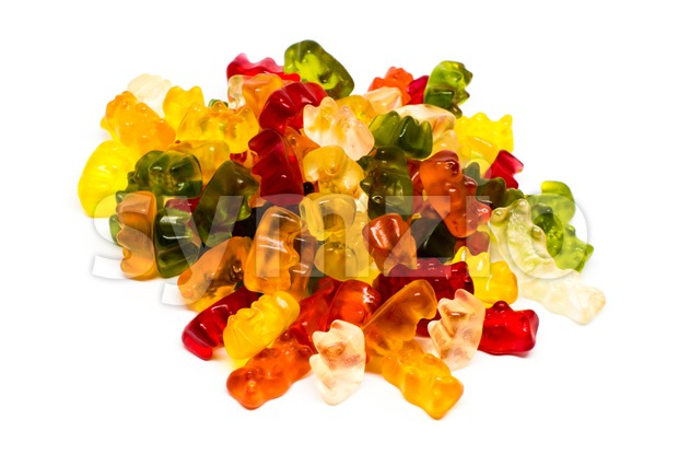 Heap of jelly bears or gummy bears candies isolated on white background