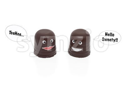 two chocolate marshmallows having a conversation Stock Photo