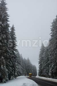 Lorry driving on winter road Stock Photo