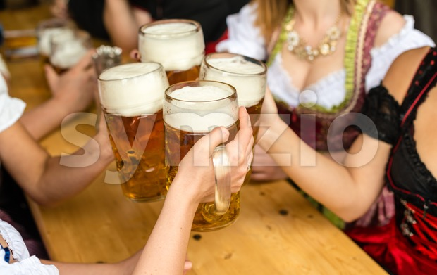 Bavarian girls drinking beer Stock Photo