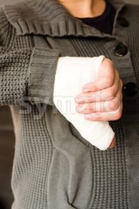 Thumb down by bandaged hand Stock Photo