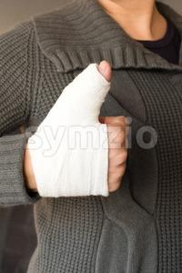 Thumbs up with bandage Stock Photo