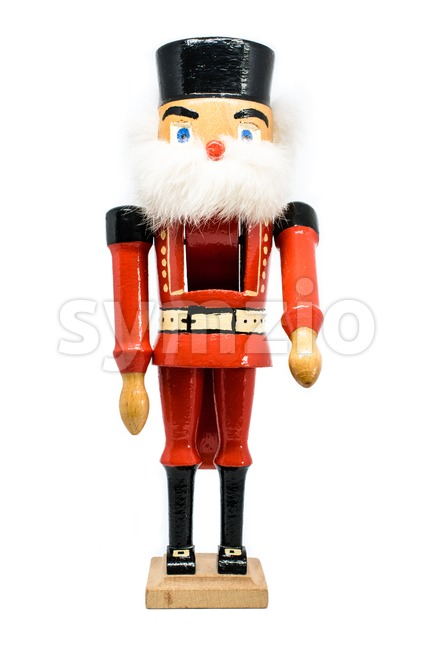 Traditional handmade figurine Christmas nutcracker wearing an old military style uniform - studio shot on white background